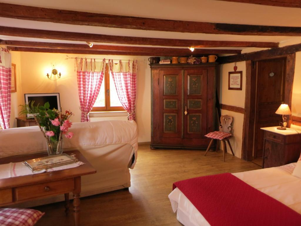 A bed or beds in a room at Le Jardin de l'Ill