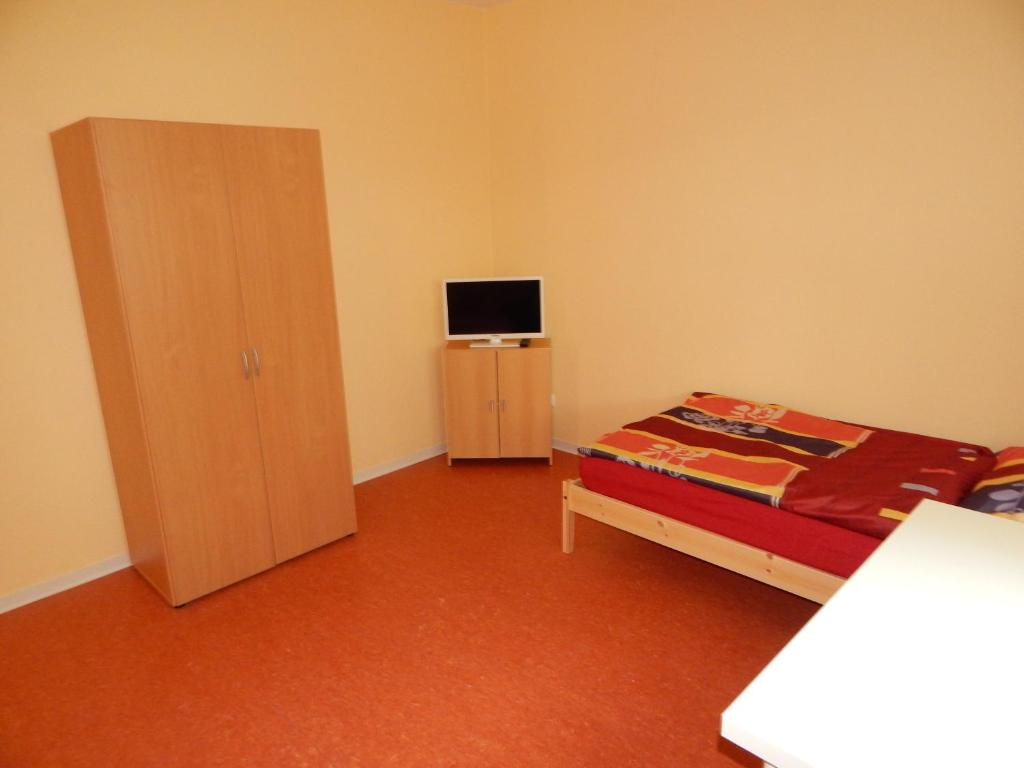 A bed or beds in a room at Home at Friends' - City - Zu Hause bei Freunden