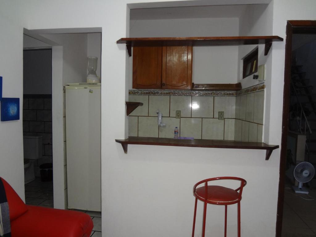 A kitchen or kitchenette at Condomínio Mar Azul