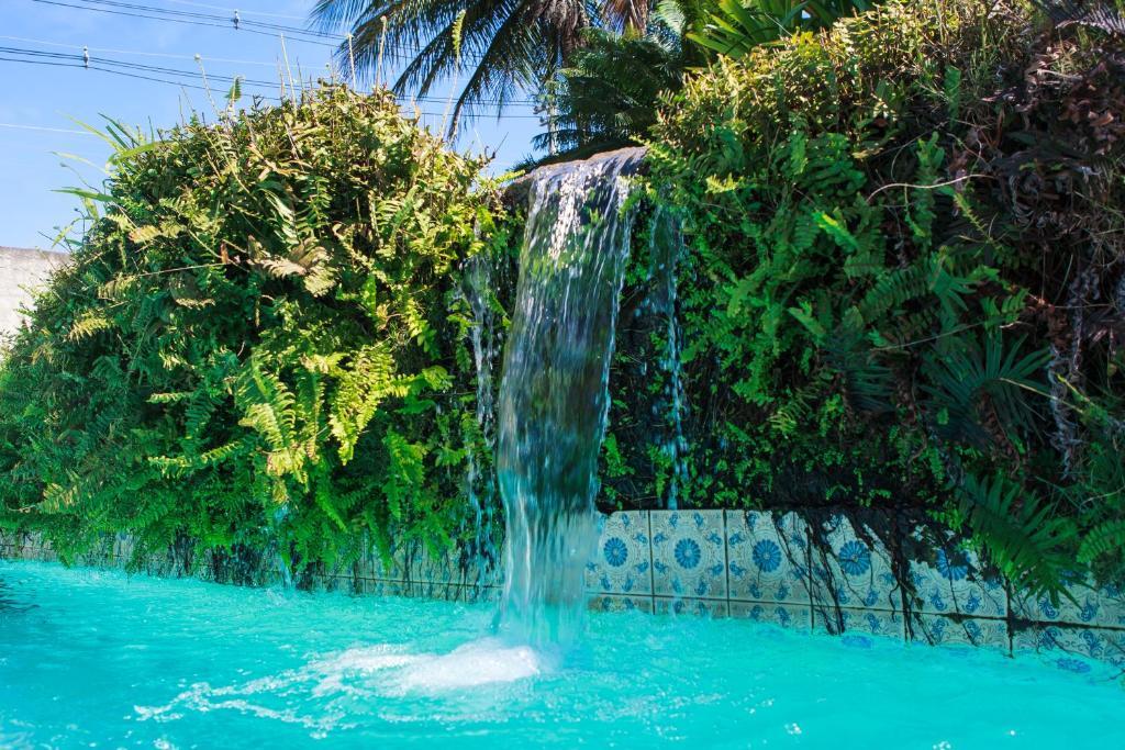 The swimming pool at or near Guarapousada