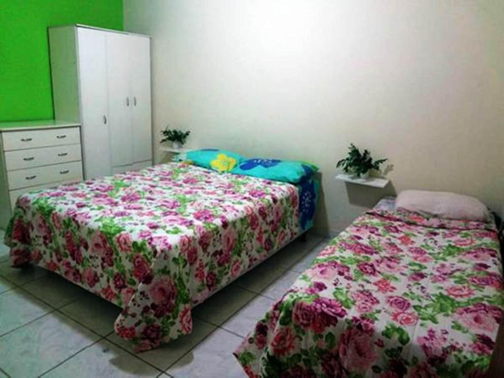 A bed or beds in a room at Residencial Brisa do Peró