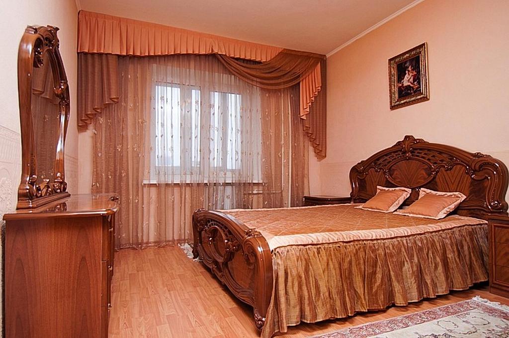 Кровать или кровати в номере Апартаменты Командировка 74