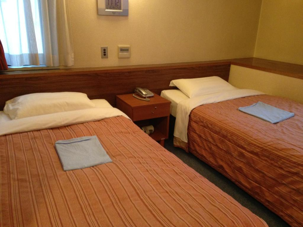 A bed or beds in a room at Tourist Hotel