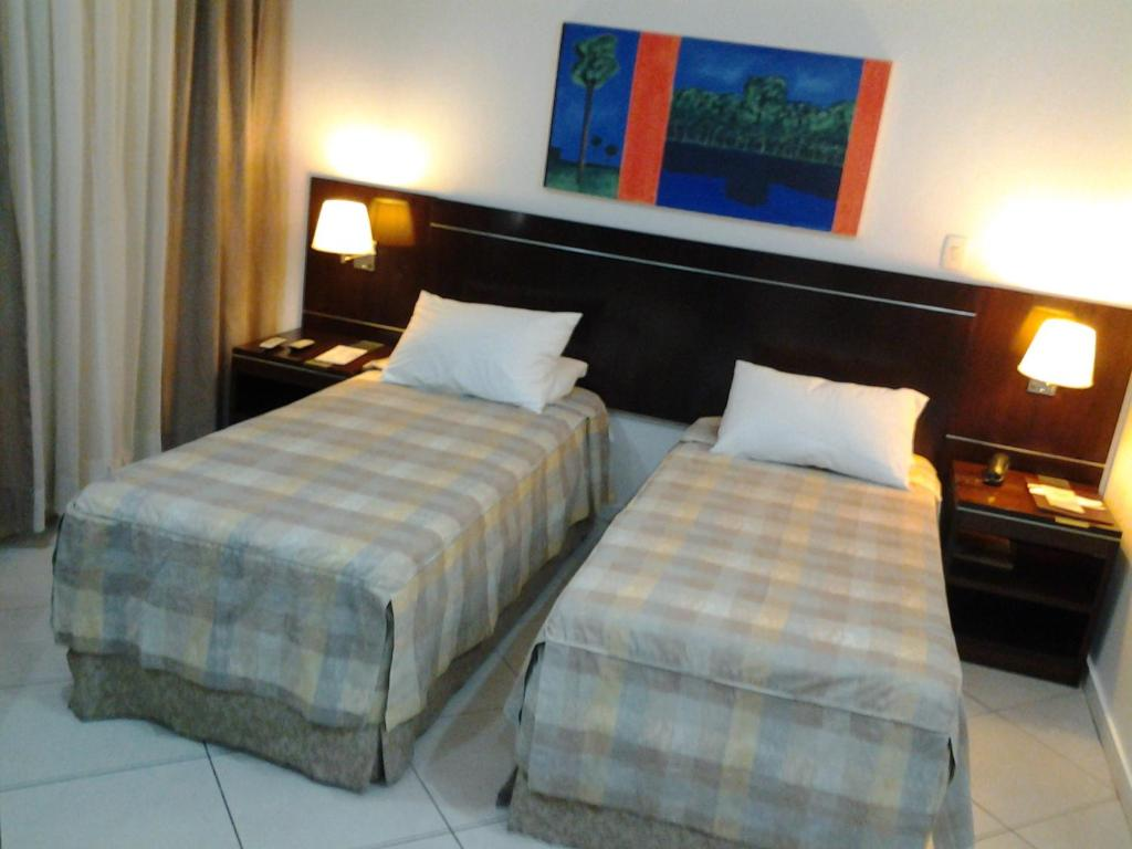 A bed or beds in a room at Flat Millenium