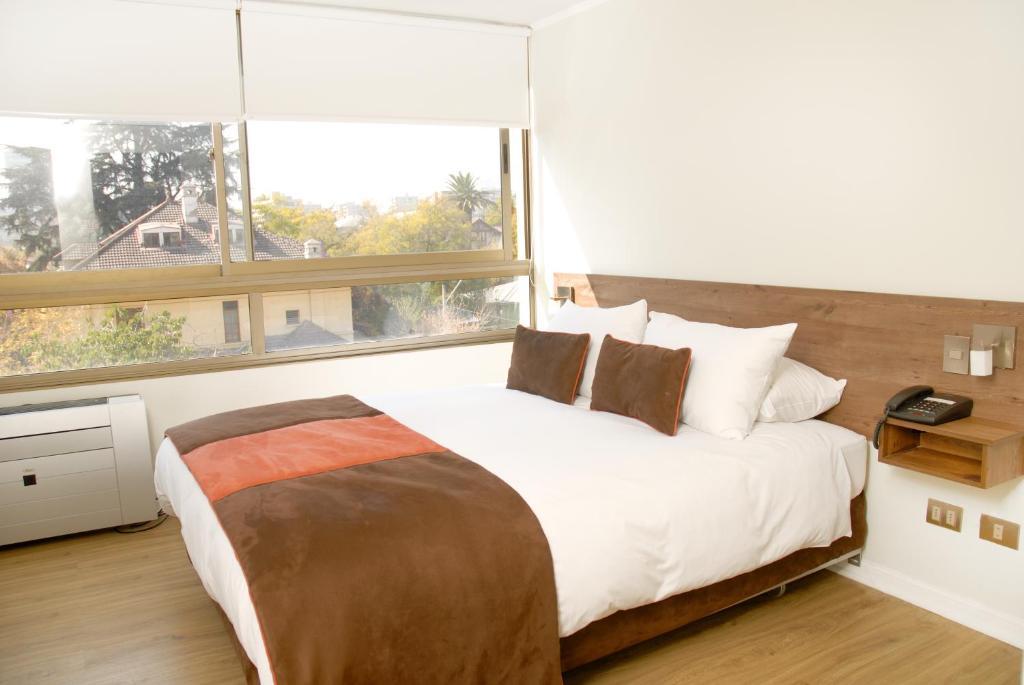 Cama ou camas em um quarto em Apart Hotel Providencia