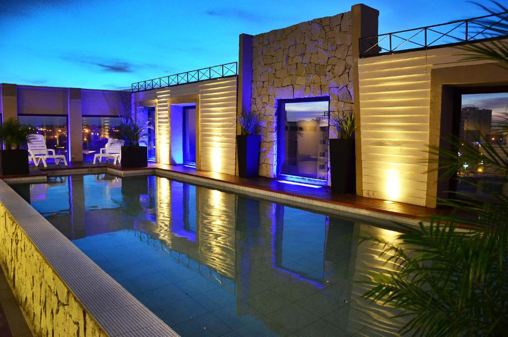 The swimming pool at or near Le Parc Hotel & Suite