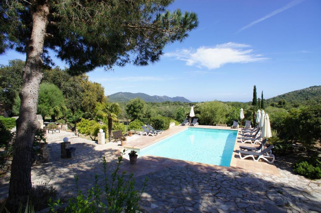 The swimming pool at or near El Encinar de Arta