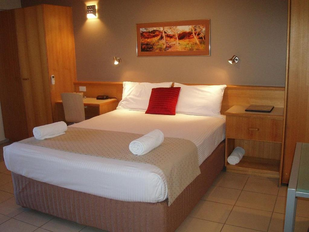 A bed or beds in a room at Boat Harbour Studio Apartments and Villas