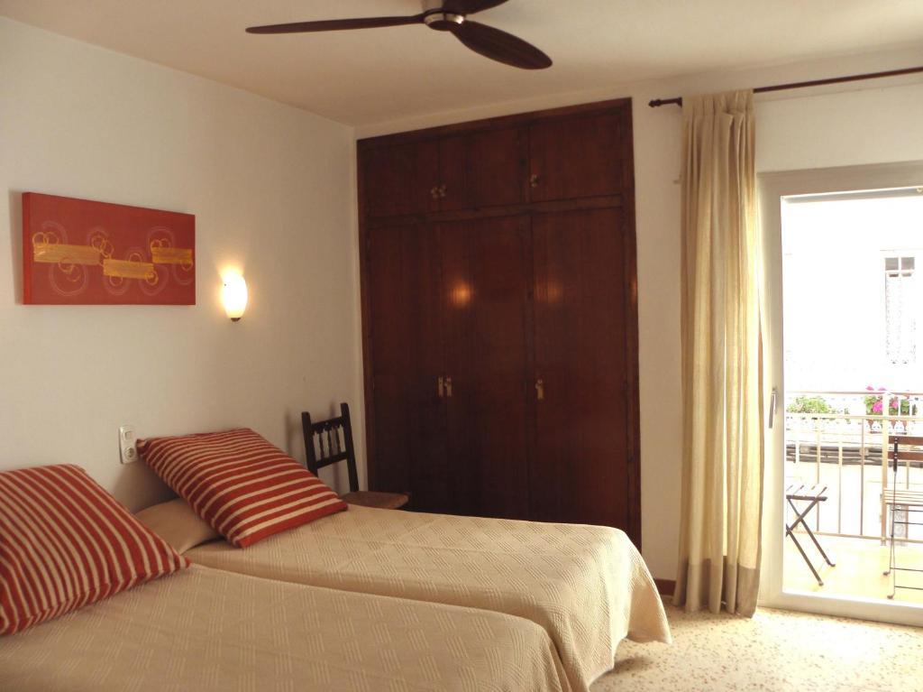 Llit o llits en una habitació de Pensió Vista Alegre