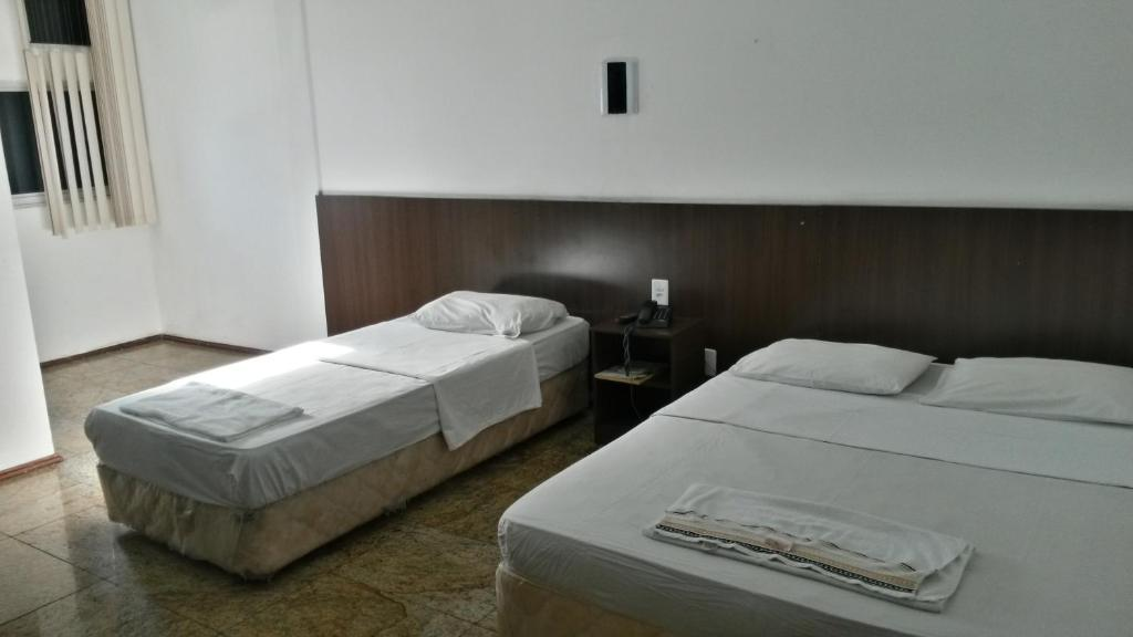 A bed or beds in a room at Hotel Ana Cassia