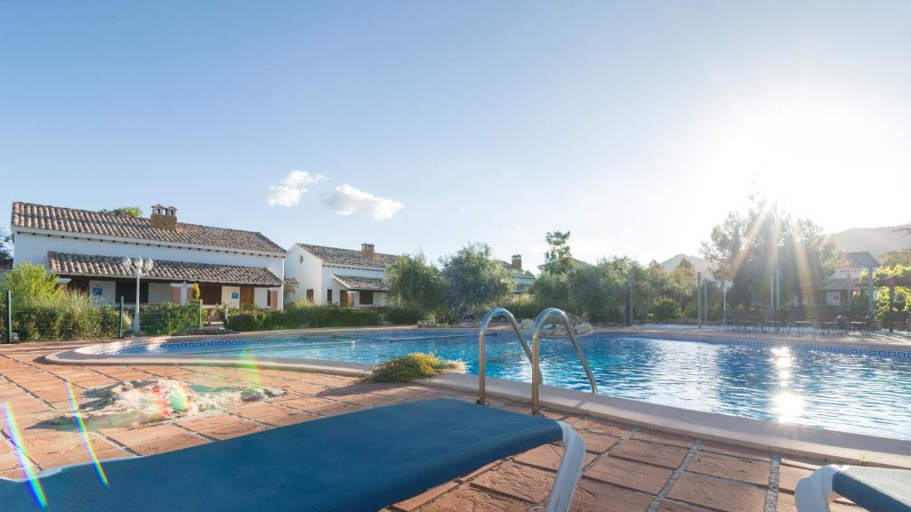 The swimming pool at or near Complejo Rural Ibipozo