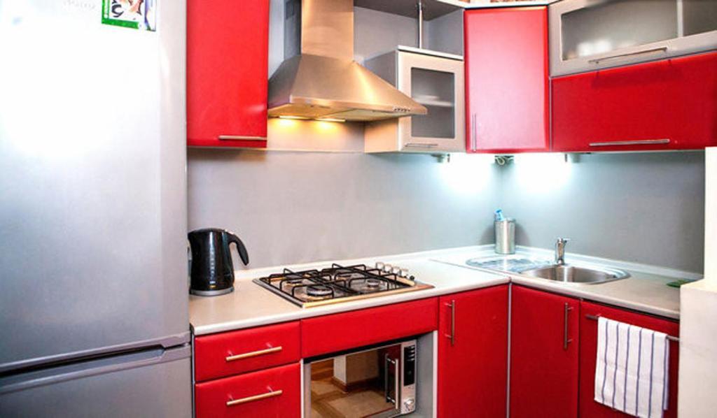 A kitchen or kitchenette at Bolshaya Morskaya Apartment