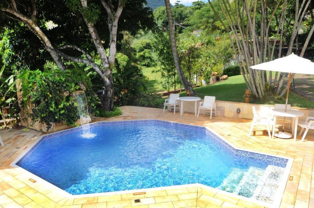 The swimming pool at or near Pousada Pedra Menina