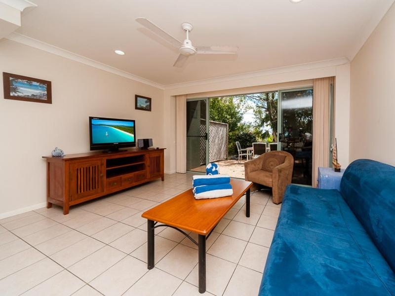 A television and/or entertainment center at Sunset Waters 6 - Hamilton Island