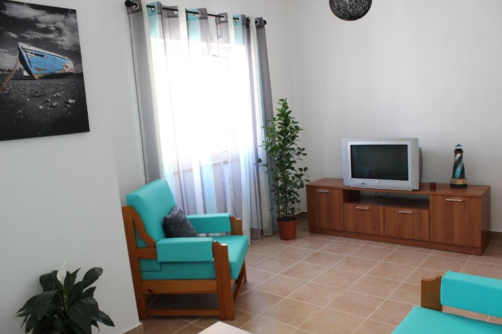 A television and/or entertainment center at Casa Da Baía