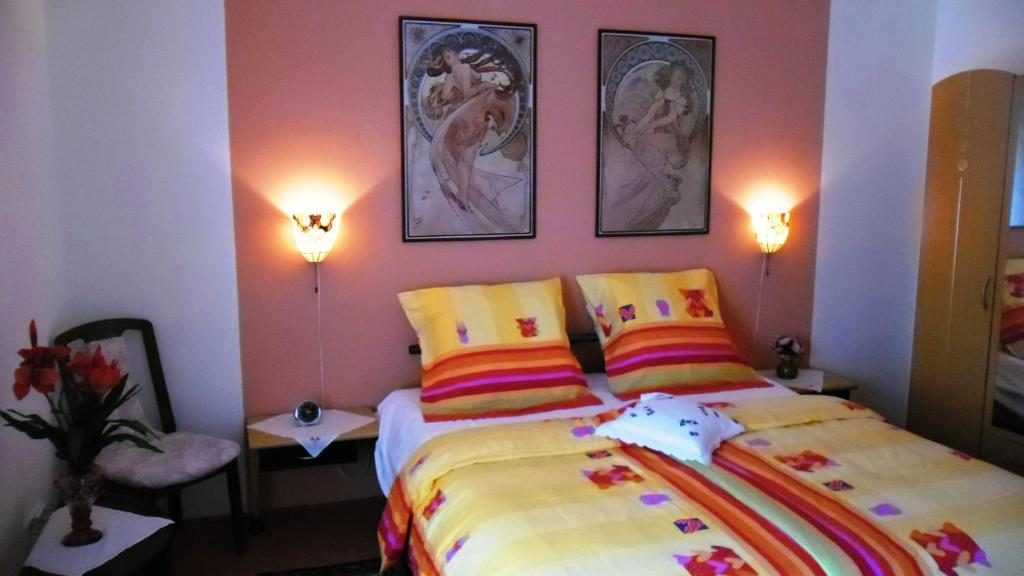 A bed or beds in a room at Apartmany Sabo