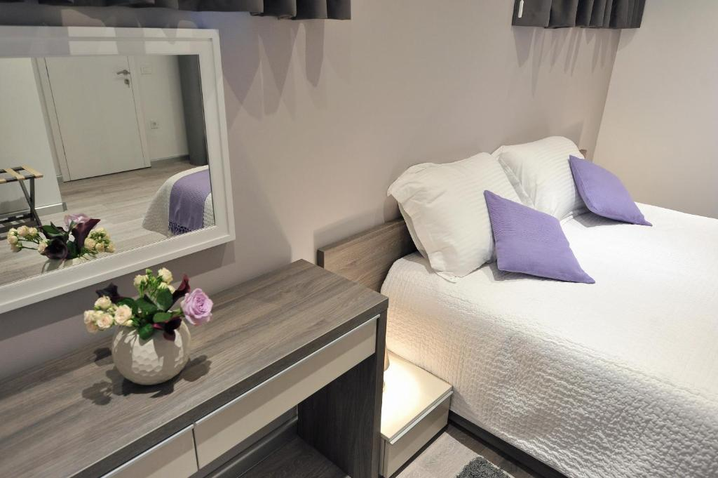 Krevet ili kreveti u jedinici u objektu Apartments & Rooms Lavandula Exclusive