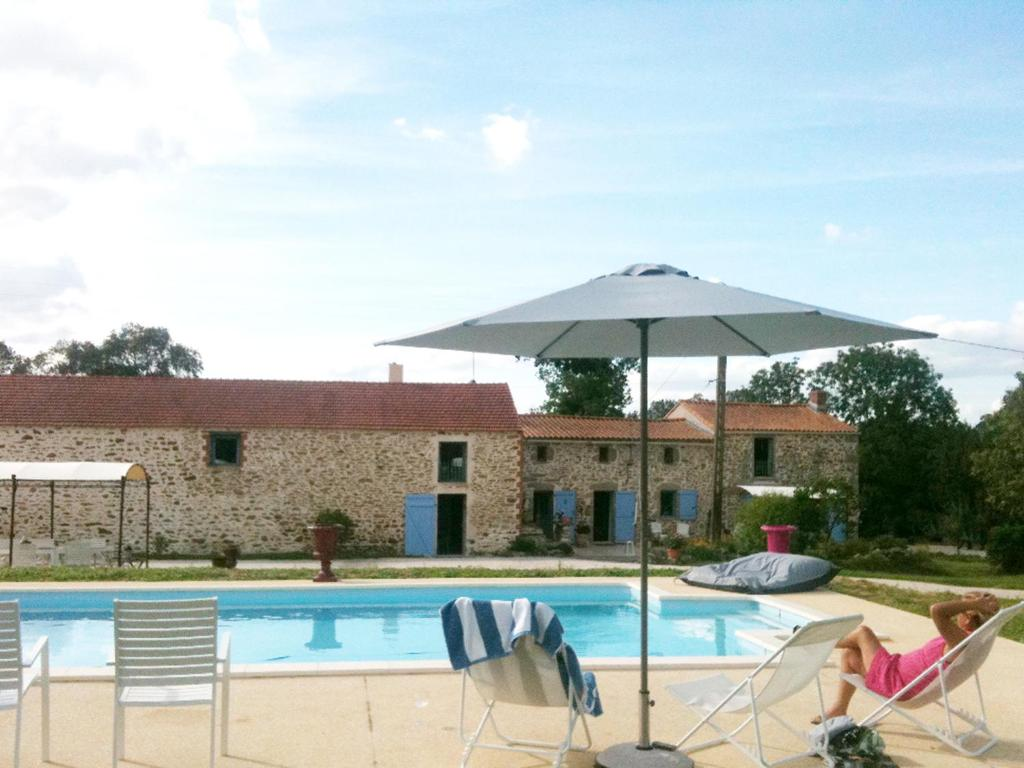 The swimming pool at or near Le Clos du Gâts