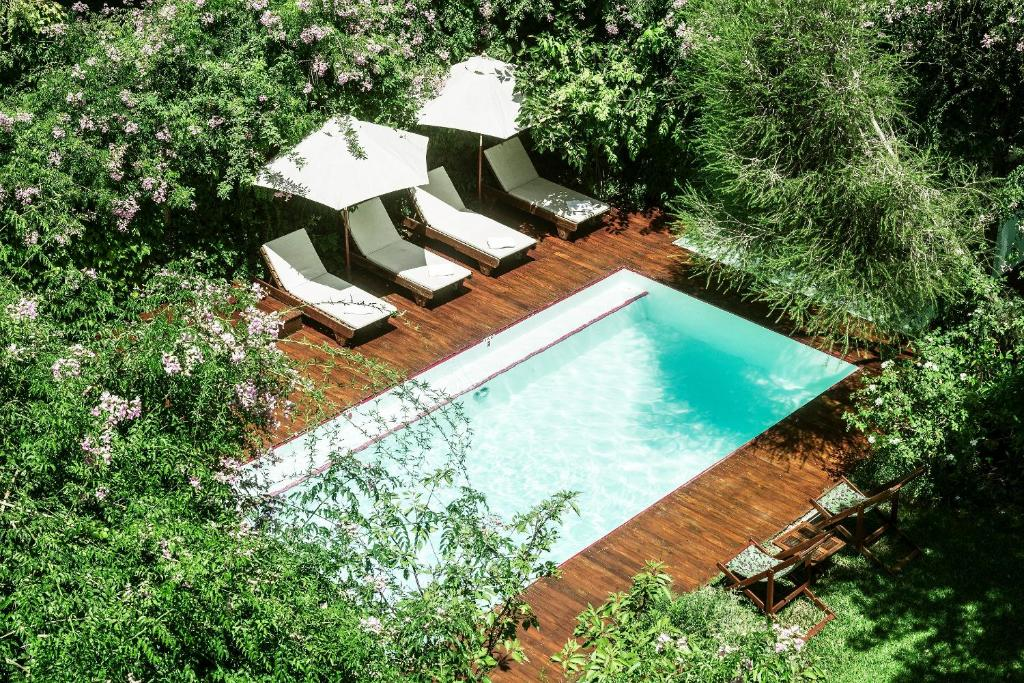 A view of the pool at Home Hotel or nearby