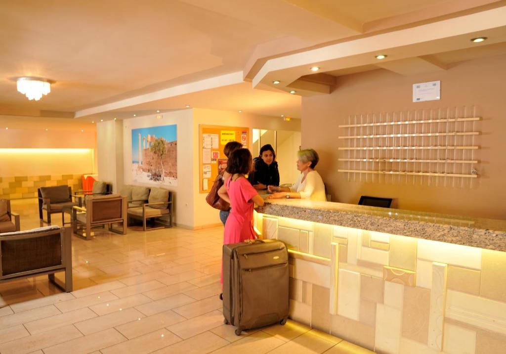 The lobby or reception area at Carina Hotel