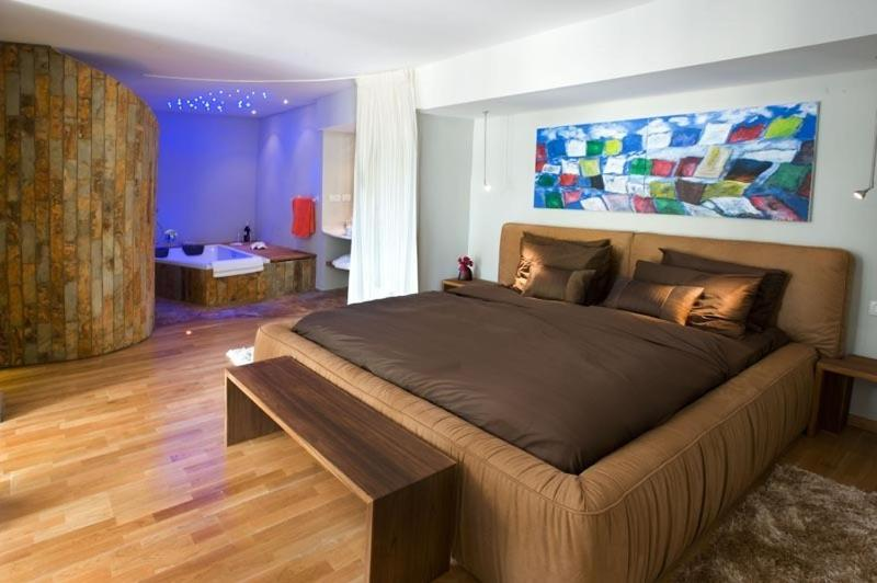 A bed or beds in a room at Romantic suite in Caesarea