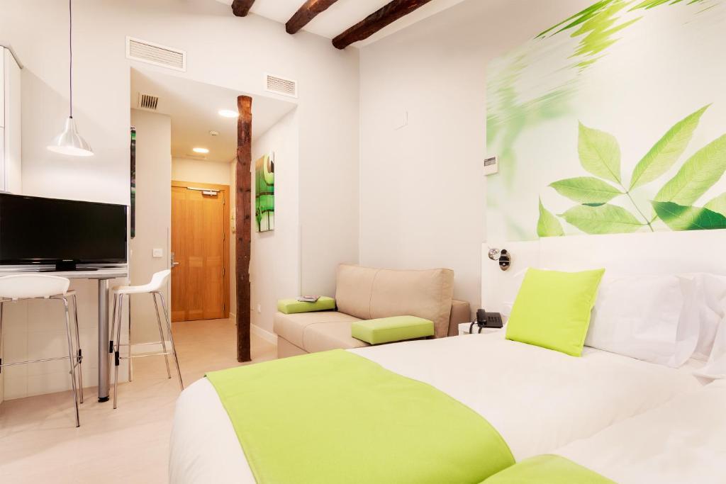 Cama o camas de una habitación en Apartamentos Blume Cruz by Aspasios