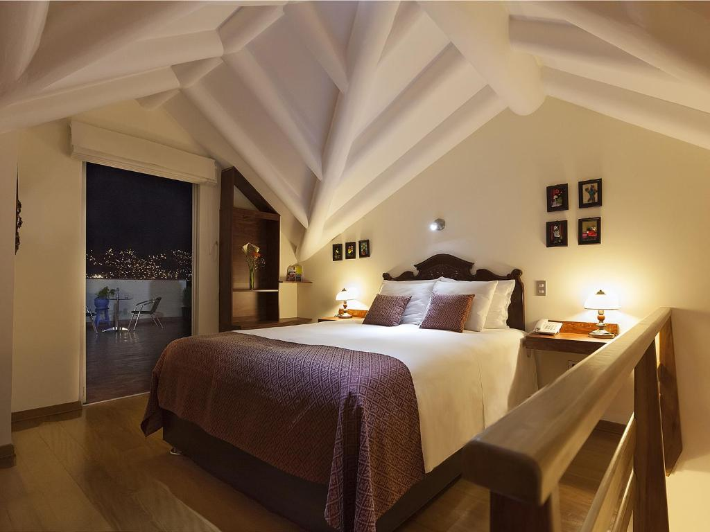A bed or beds in a room at Tandapata Boutique Hotel