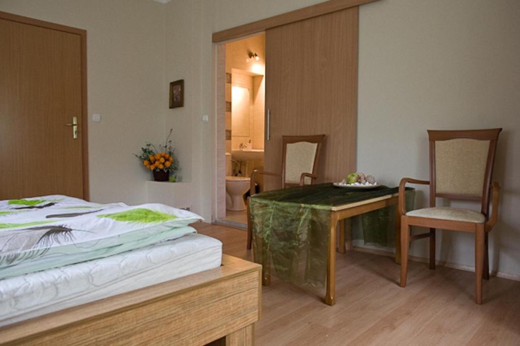 Łóżko lub łóżka w pokoju w obiekcie Vital House