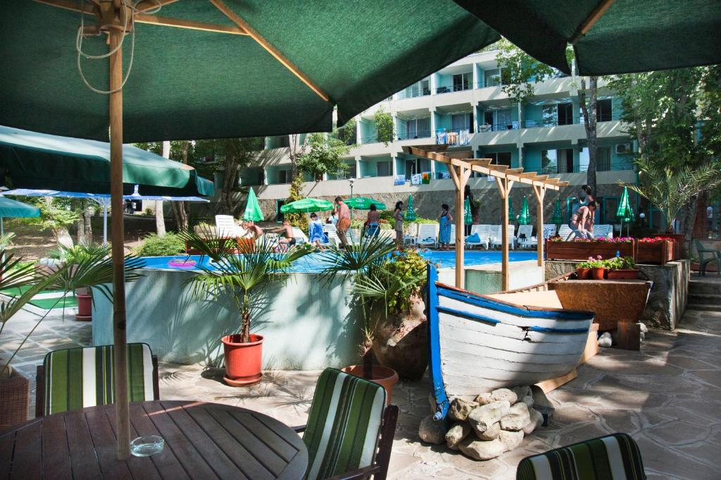 The swimming pool at or near Ariana Hotel