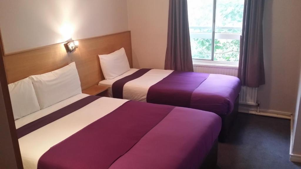 Cama o camas de una habitación en Arriva Hotel