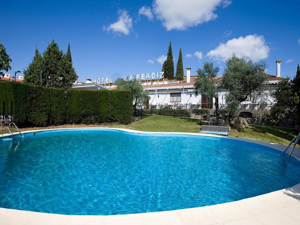 The swimming pool at or near Hotel la Perdiz