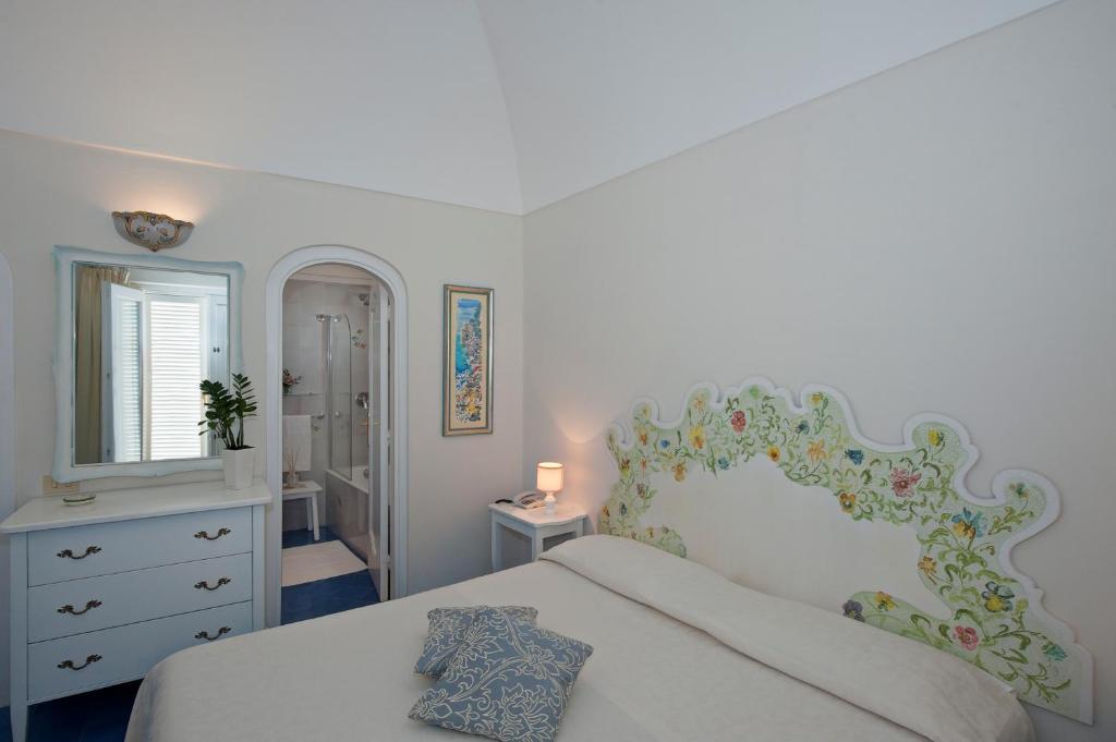 Letto o letti in una camera di Villa La Tartana