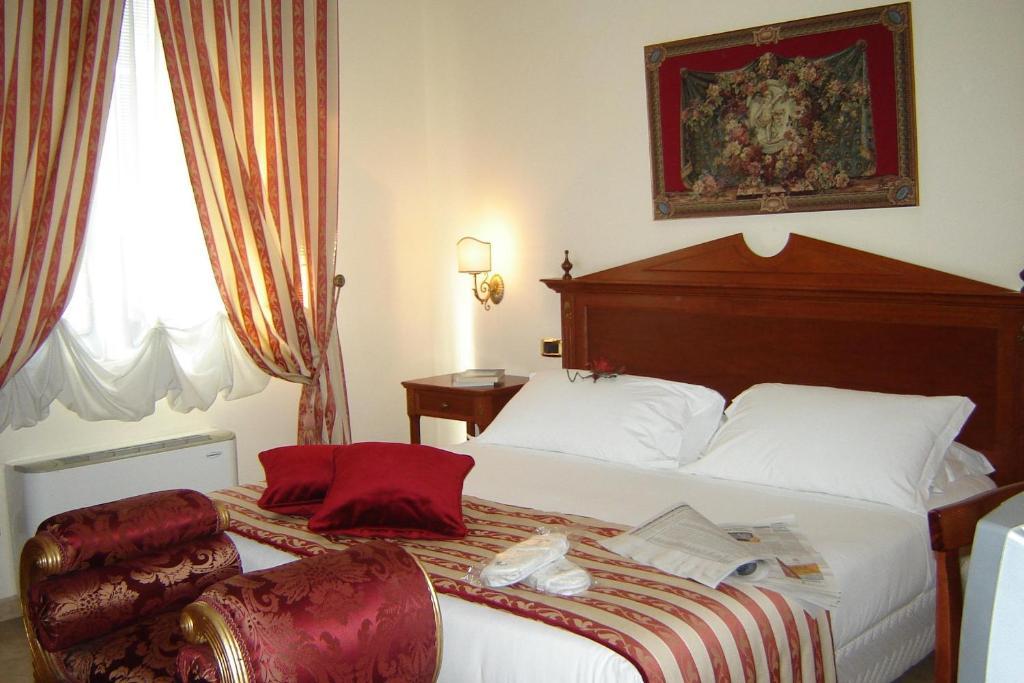 Letto o letti in una camera di D'Angelo Palace Hotel