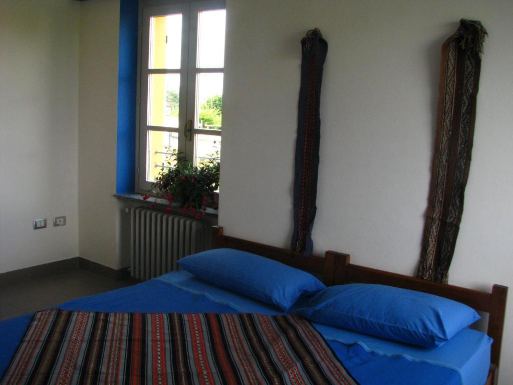 Ein Bett oder Betten in einem Zimmer der Unterkunft Ostello del Po