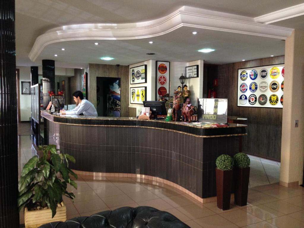 The lobby or reception area at Hotel Bons Tempos