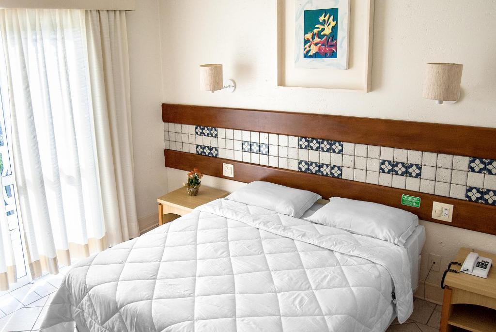 Cama o camas de una habitación en Hotel Torres da Cachoeira
