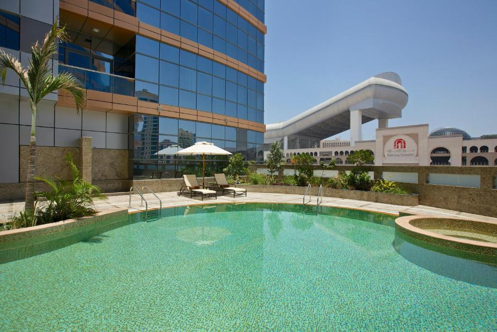The swimming pool at or near DoubleTree by Hilton Hotel and Residences Dubai – Al Barsha