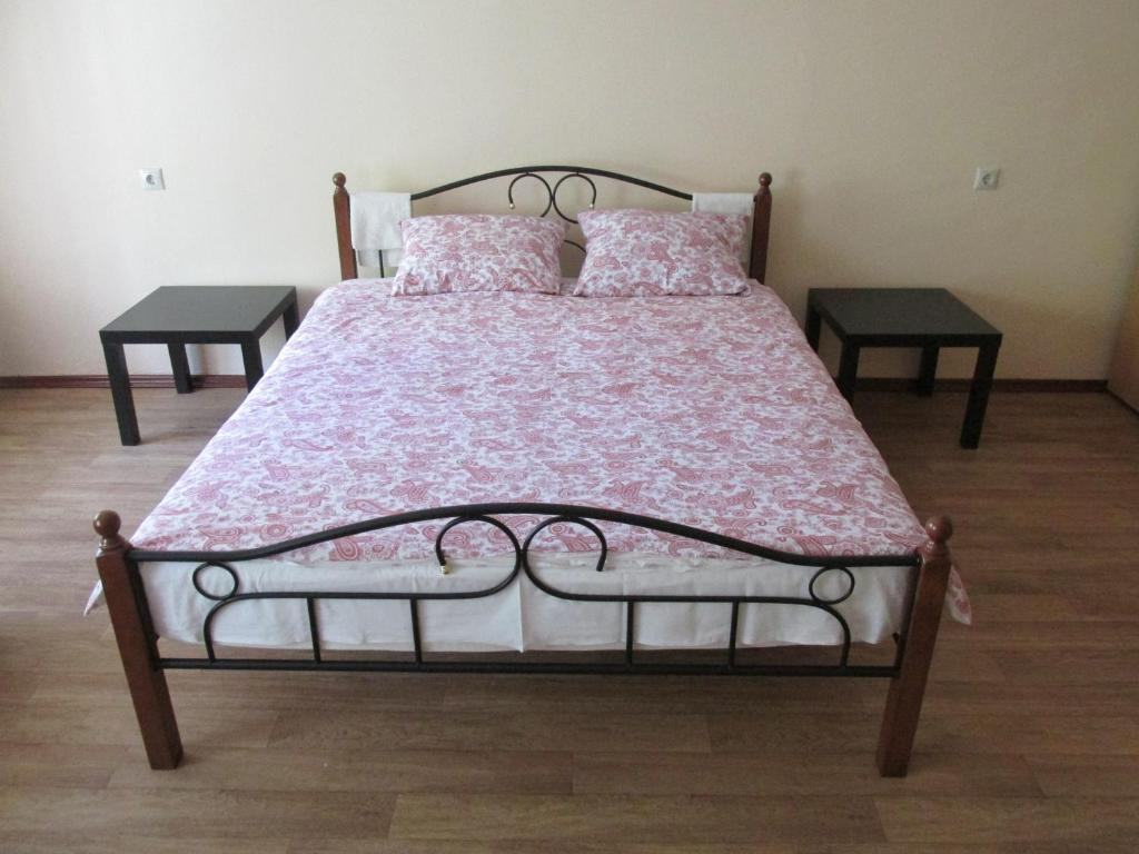 Кровать или кровати в номере Гостиный двор на Полянке