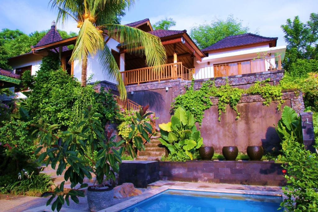 The swimming pool at or close to Bali Marina Villa's
