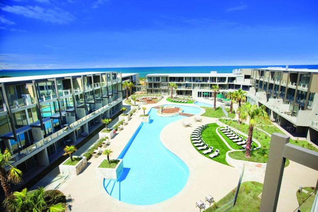 A view of the pool at Beachfront Resort Torquay, Australia or nearby