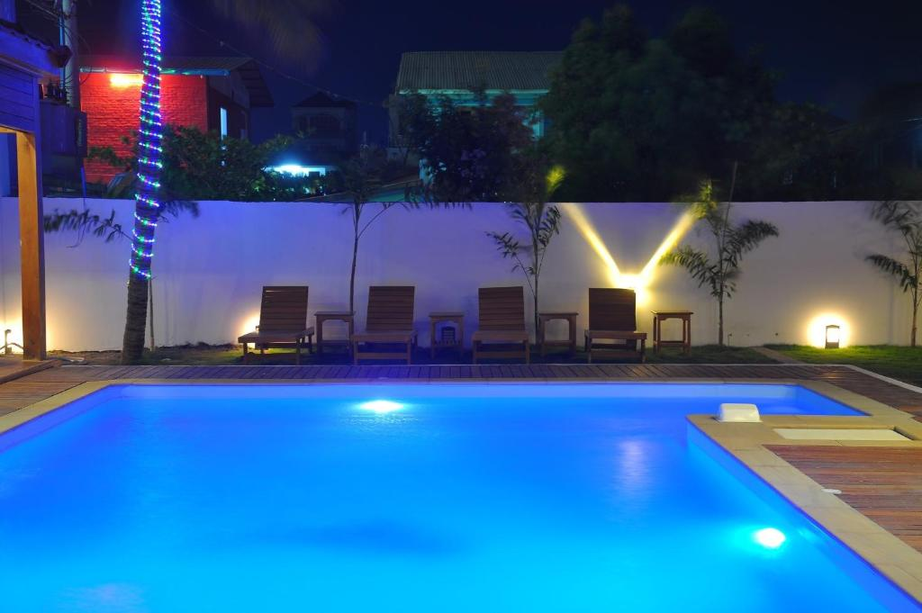 The swimming pool at or near Paragon Hotel