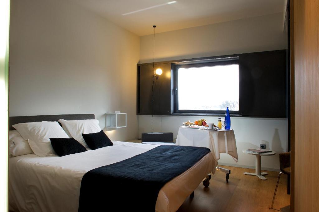 Cama o camas de una habitación en Elegance Almansa