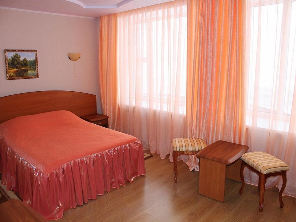 Кровать или кровати в номере Гостиница Воркута