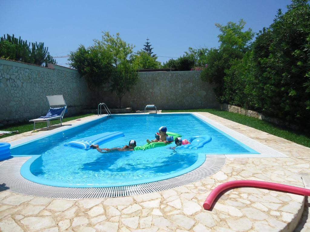 The swimming pool at or near Villa Dafne
