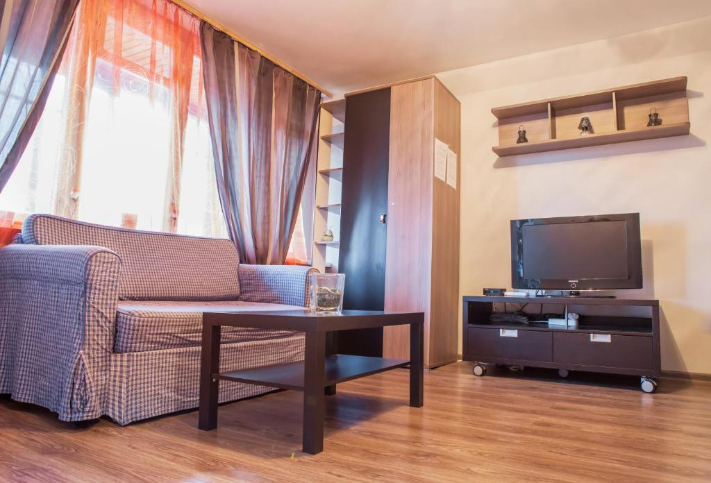 Гостиная зона в Flation Апартаменты Динамо