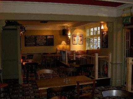 A restaurant or other place to eat at The Cranley Hotel