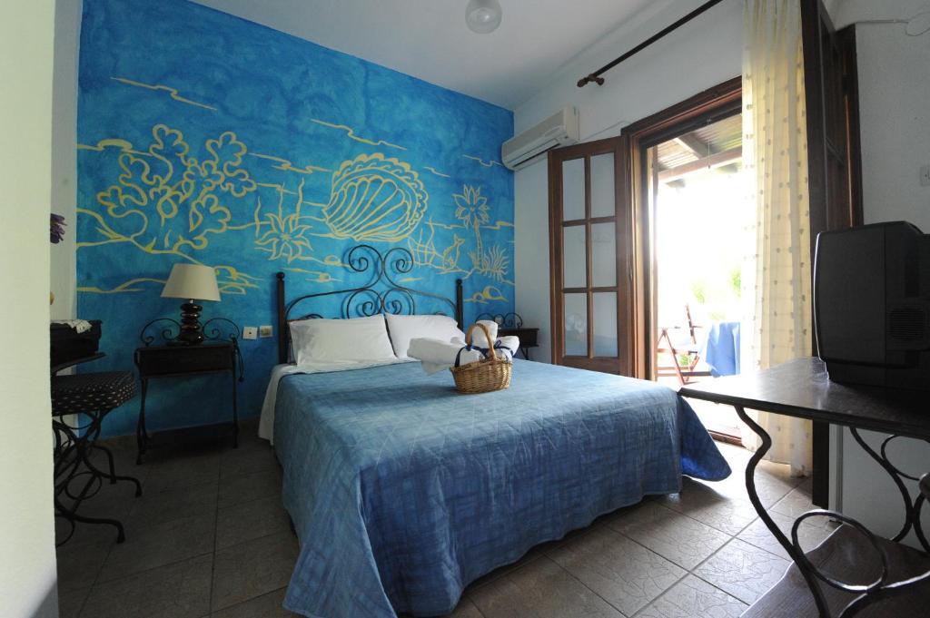 Ένα ή περισσότερα κρεβάτια σε δωμάτιο στο Thalassa Hotel
