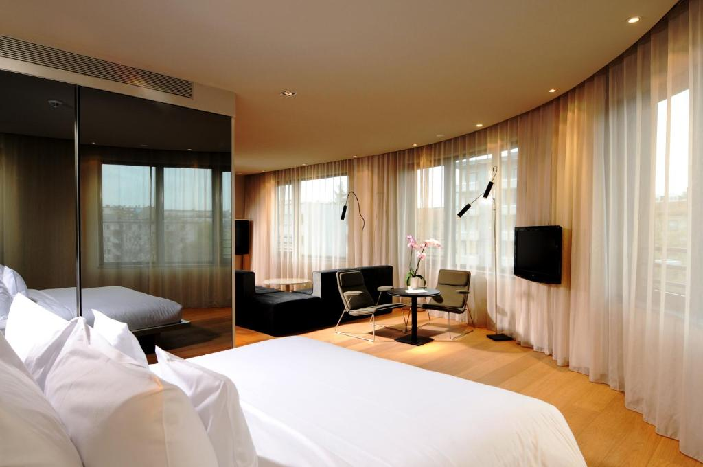 A bed or beds in a room at SANA Berlin Hotel