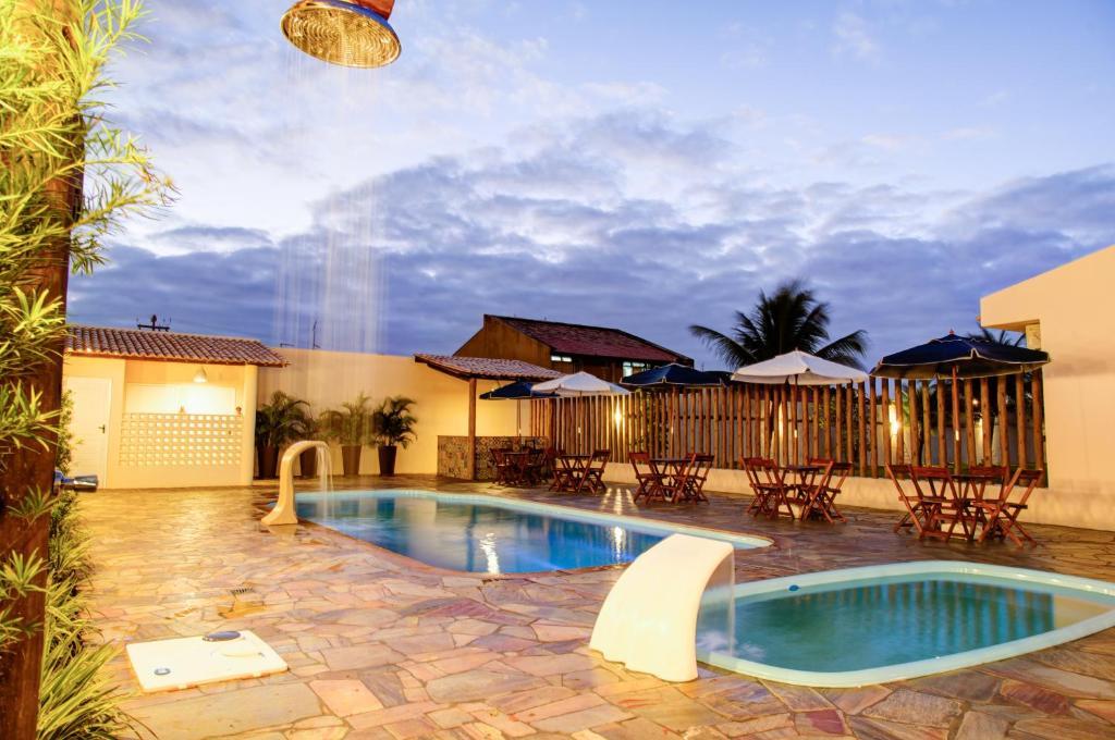 The swimming pool at or near Hotel Mar do Farol