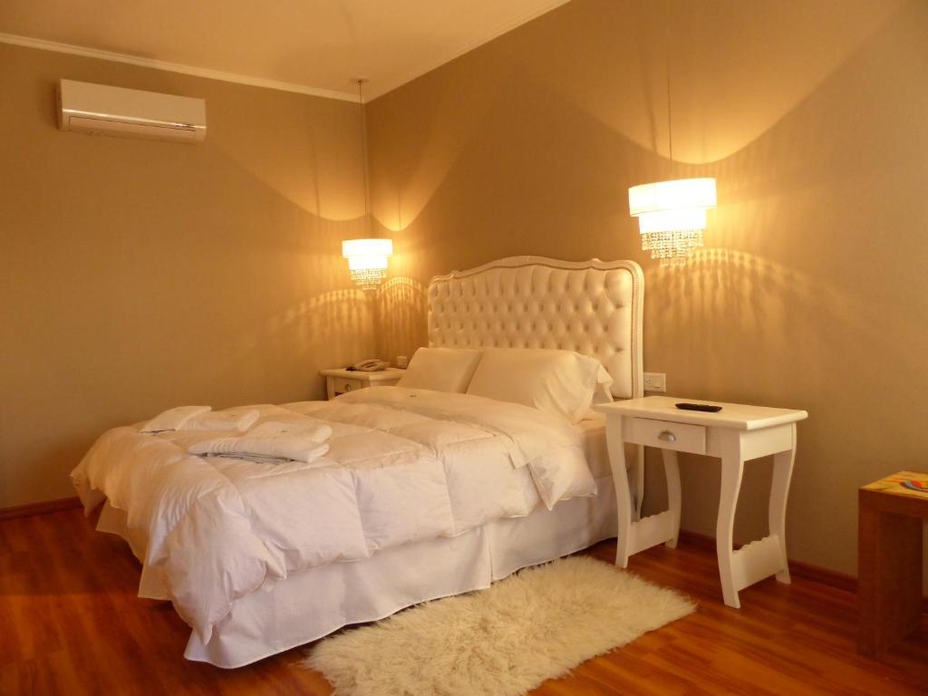 Кровать или кровати в номере Euskadi Hotel